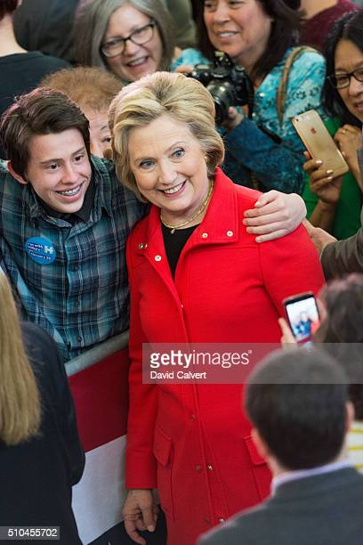 Democratic Presidential candidate and former Secretary of State Hillary Clinton poses with a supporter following a campaign rally at Truckee Meadows...