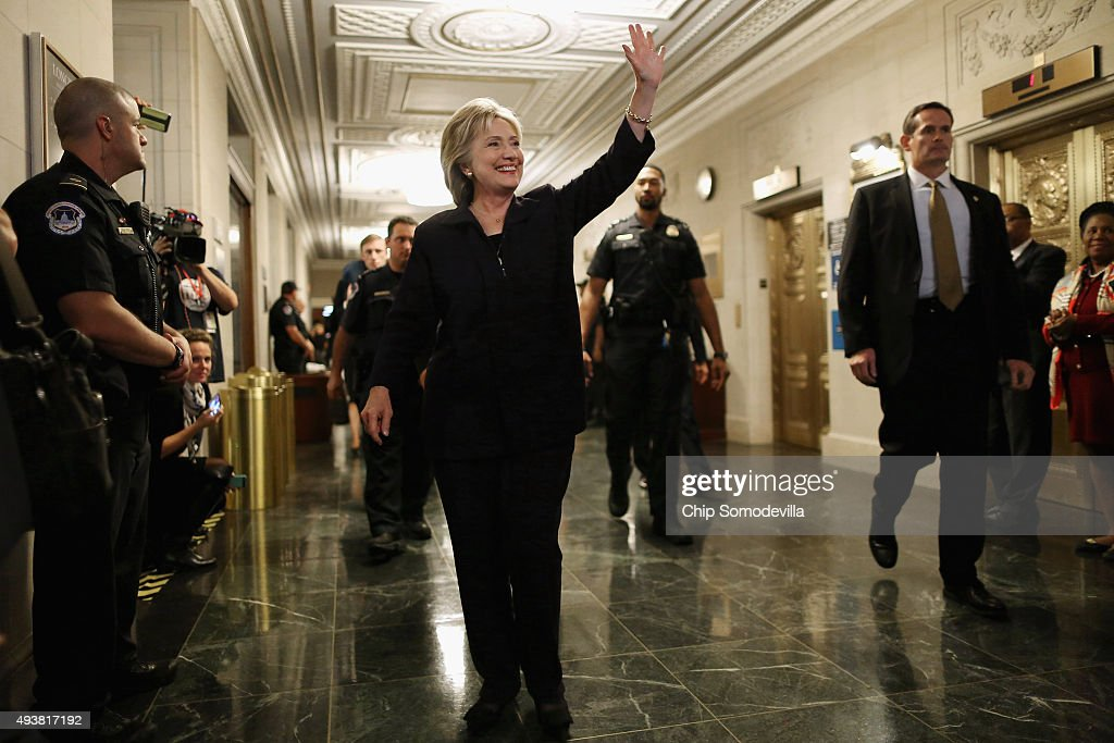 Democratic presidential candidate and former Secretary of State Hillary Clinton waves goodbye to journalists after testifying to the House Select Committee on Benghazi in the Longworth House Office Building October 22, 2015 on Capitol Hill in Washington, DC. The committee held a hearing to continue its investigation on the attack that killed Ambassador Chris Stevens and three other Americans at theÊdiplomatic compound in Benghazi, Libya,Êon the evening of September 11, 2012.