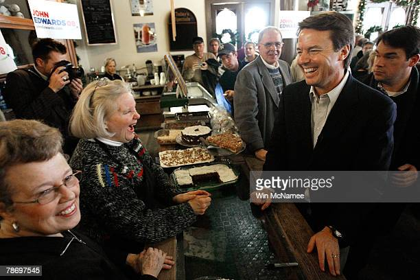Democratic presidential candidate and former Sen John Edwards greets employees after speaking to undecided caucus goers at a campaign event at the...