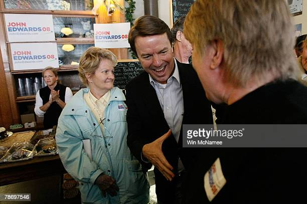 Democratic presidential candidate and former Sen John Edwards greets undecided caucus goers at a campaign event at the Ivy Bake Shoppe January 2 2008...