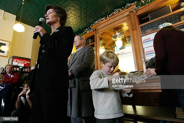 Democratic presidential candidate and former Sen John Edwards' son Jack eats a piece of chocolate cake while waiting for his father to be introduced...