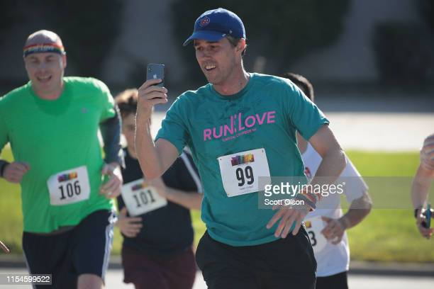 Democratic presidential candidate and former Texas congressman Beto O'Rourke nears the finish line in the Pride Fest Fun Run 5K on June 08 2019 in...