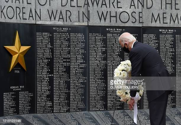 Democratic presidential candidate and former US Vice President Joe Biden with his wife Jill Biden pay their respects to fallen service members on...