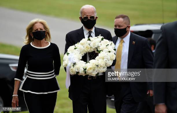 Democratic presidential candidate and former US Vice President Joe Biden with his wife Jill Biden arrive to pay their respects to fallen service...