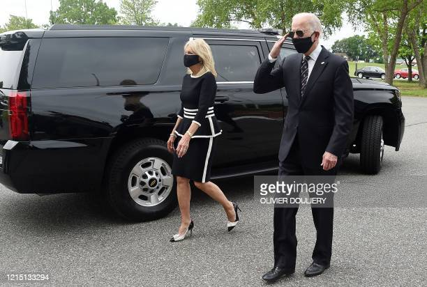 Democratic presidential candidate and former US Vice President Joe Biden salutes veterans while walking with his wife Jill at the Delaware Memorial...