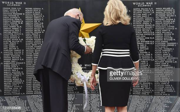 Democratic presidential candidate and former US Vice President Joe Biden and his wife Jill Biden pay their respects to fallen service members on...