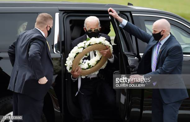 Democratic presidential candidate and former US Vice President Joe Biden arrives to pay his respects to fallen service members on Memorial Day at...
