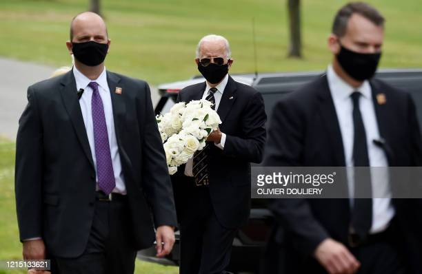 Democratic presidential candidate and former US Vice President Joe Biden and his wife Jill Biden arrive to pay their respects to fallen service...