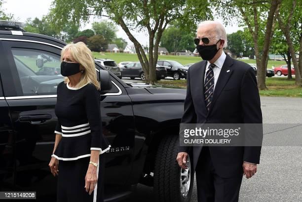 Democratic presidential candidate and former US Vice President Joe Biden walks with his wife Jill at the Delaware Memorial Bridge Veteran's Memorial...