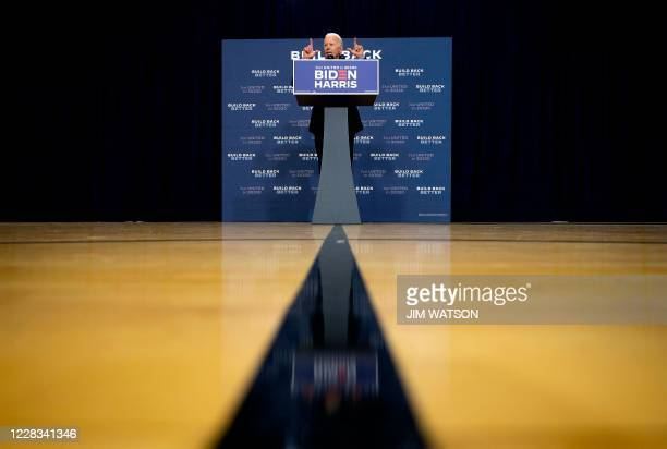 Democratic presidential candidate and former US Vice President Joe Biden answers the press during a press conference on the state of the US economy...