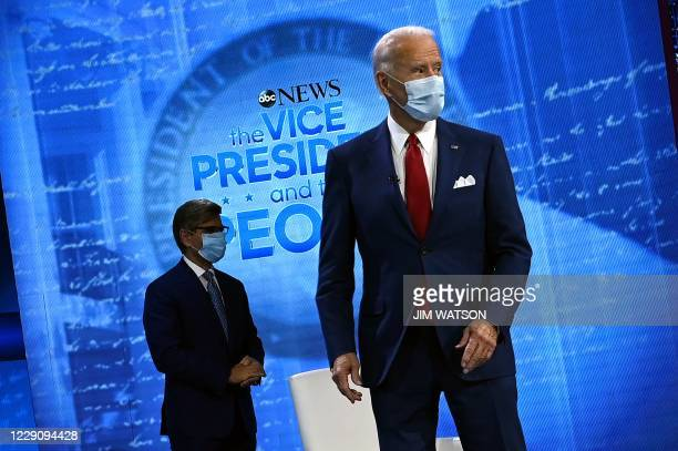Democratic Presidential candidate and former US Vice President Joe Biden and moderator George Stephanopoulos arrive for an ABC News town hall event...