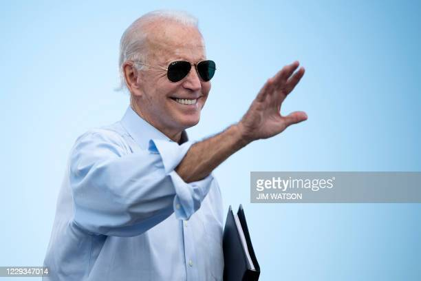 Democratic Presidential candidate and former US Vice President Joe Biden gestures prior to delivering remarks at a Drive-in event in Coconut Creek,...