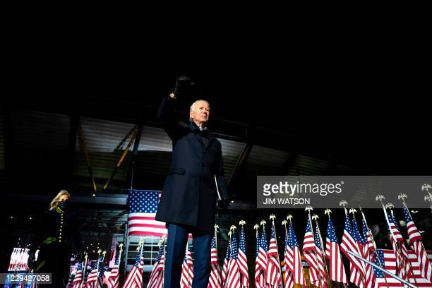 Democratic Presidential candidate and former US Vice President Joe Biden, alongside wife Jill Biden wave to supporters, after speaking during a...