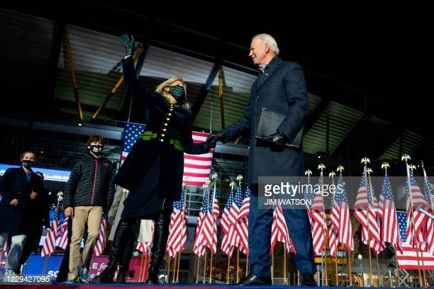 Democratic Presidential candidate and former US Vice President Joe Biden, alongside wife Jill Biden and some of his grandkids, gestures after...
