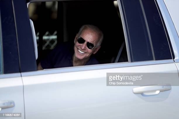 Democratic presidential candidate and former Vice President Joe Biden rolls down the window of his truck to say goodbye to supporters as he leaves...