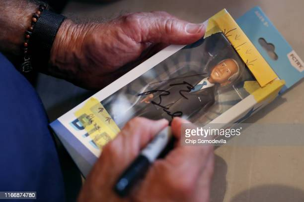 Democratic presidential candidate and former Vice President Joe Biden autographs a boxed figurine of himself during the Iowa State Fair August 08...