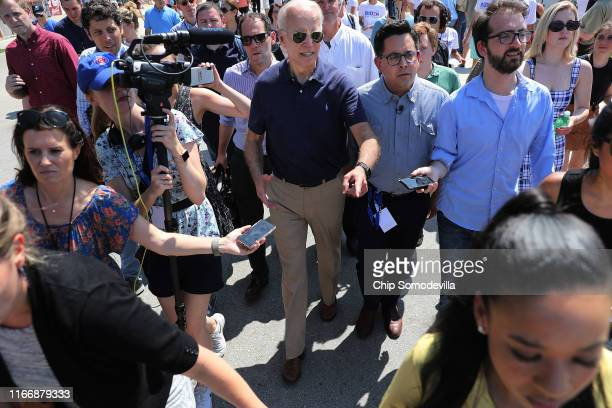 Democratic presidential candidate and former Vice President Joe Biden is surrounded by journalists as he heads for the exits at the Iowa State Fair...
