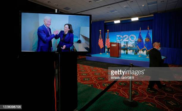 Democratic presidential candidate and former Vice President Joe Biden and his vice presidential running mate Senator Kamala Harris appear on a video...