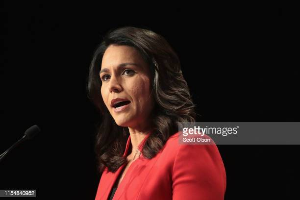 Democratic presidential candidate and Hawaii congresswoman Tulsi Gabbard speaks at the Iowa Democratic Party's Hall of Fame Dinner on June 9 2019 in...