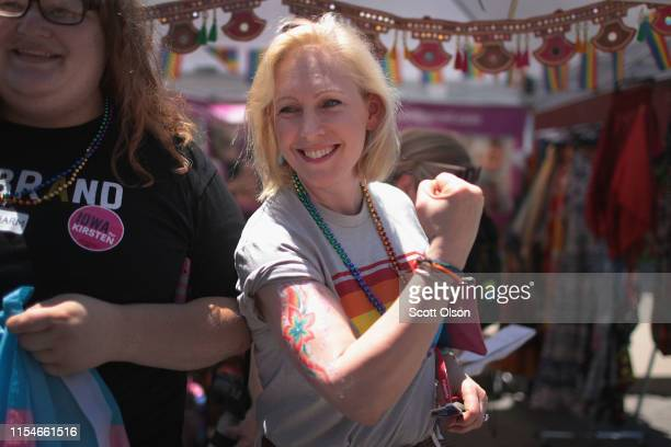 Democratic presidential candidate and New York senator Kirsten Gillibrand shows off an arm painting she had done during a campaign stop at the...