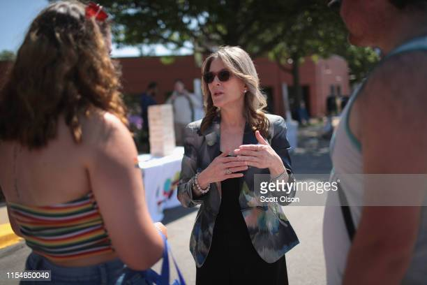 Democratic presidential candidate and self-help author Marianne Williamson greets people while campaigning at the Capital City Pride Fest on June 08,...
