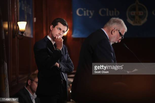 Democratic presidential candidate and South Bend, Indiana Mayor Pete Buttigieg listens to a question from a guest after speaking at a luncheon hosted...