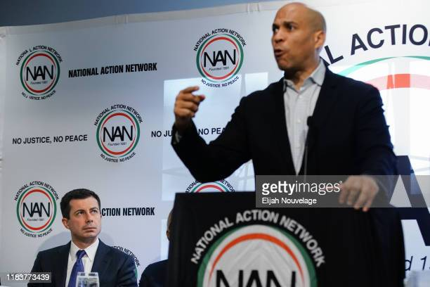 S Democratic presidential candidate and South Bend Indiana Mayor Pete Buttigieg left looks on as Sen Cory Booker speaks at the National Action...