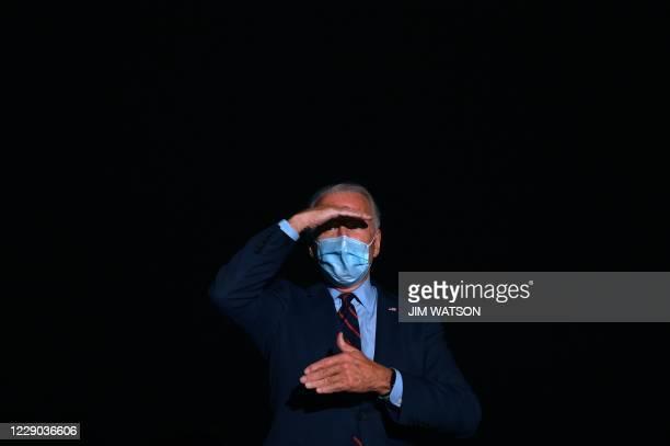 Democratic Presidential Candidate and US former Vice President Joe Biden speaks to the press as he departs Cincinnati/Northern Kentucky International...