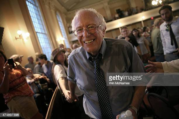 Democratic presidential candidate and US Sen Bernie Sanders finishes greeting supporters following a packed town meeting at the South Church May 27...