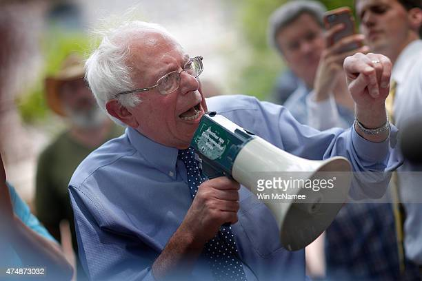 Democratic presidential candidate and US Sen Bernie Sanders speaks to an overflow crowd through a megaphone after a campaign event at the New England...