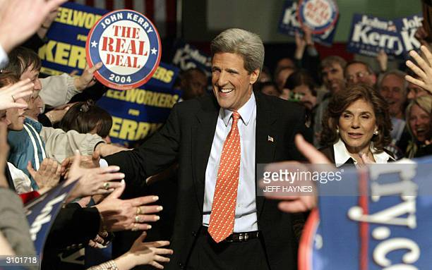 Democratic presidential candidate and US Senator John Kerry of Massachusetts and his wife Teresa Heinz-Kerry enter a rally at the Charleston Civic...