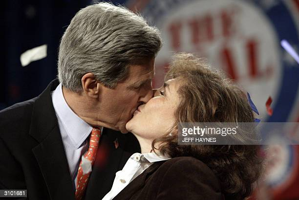Democratic presidential candidate and US Senator John Kerry of Massachusetts kisses his wife Teresa Heinz-Kerry after a rally at the Charleston Civic...