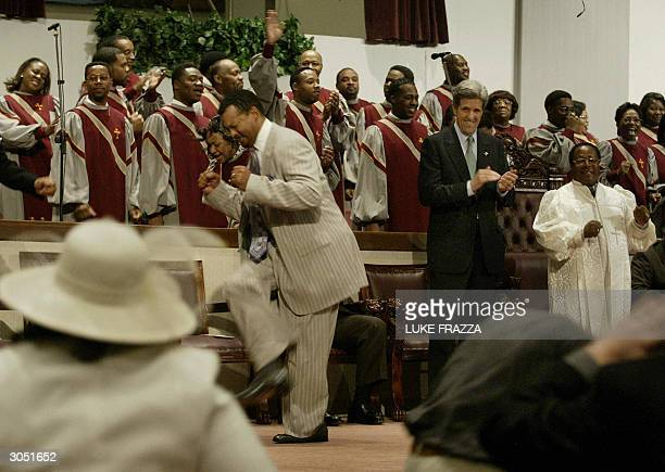 Democratic presidential candidate and US Senator John Kerry of Massacusetts attends Sunday service beside beside Pastor Bishop Phillip Coleman at the...