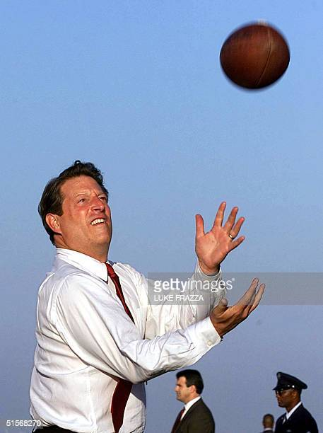 Democratic presidential candidate and US Vice President Al Gore plays football with his staff and reporters on the tarmac at Tampa International...