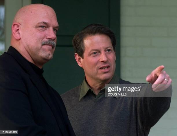 Democratic presidential candidate and US Vice President Al Gore talks with Minnesota Gov Jesse Ventura on the porch of the vice president's residence...
