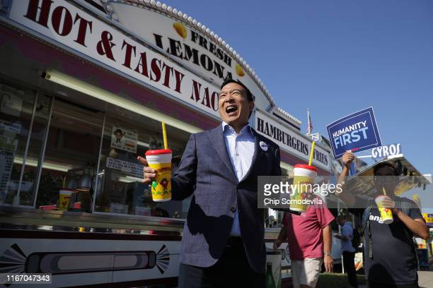 Democratic presidential candidate Andrew Yang buys lemonade for some of his staff and supporters during the Iowa State Fair August 09, 2019 in Des...