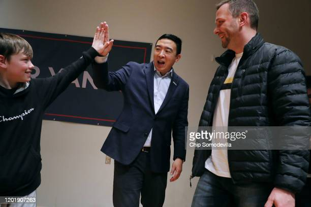 Democratic presidential candidate Andrew Yang gives a high-five to a young supporter during a town hall meeting at Cox-Snow Recital Hall at Central...