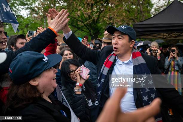 Democratic presidential candidate Andrew Yang greets supporters before taking the stage during a rally in Washington Square Park, May 14, 2019 in New...