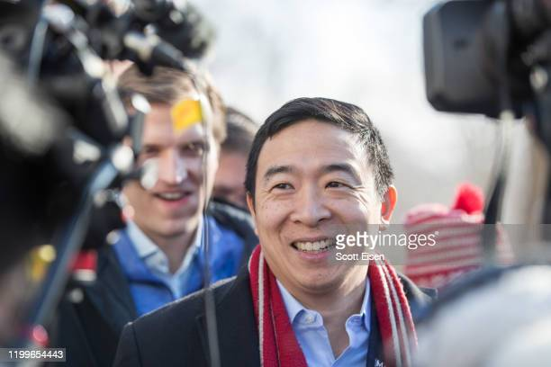 Democratic presidential candidate Andrew Yang is interviewed outside of Hopkinton Town Hall following a campaign event on February 9, 2020 in...