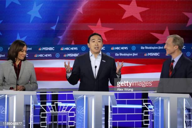 Democratic Presidential candidate Andrew Yang speaks as Sen. Kamala Harris and Tom Steyer listen during the Democratic Presidential Debate at Tyler...