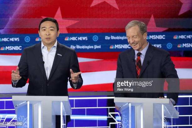 Democratic Presidential candidate Andrew Yang speaks as Tom Steyer listens during the Democratic Presidential Debate at Tyler Perry Studios November...