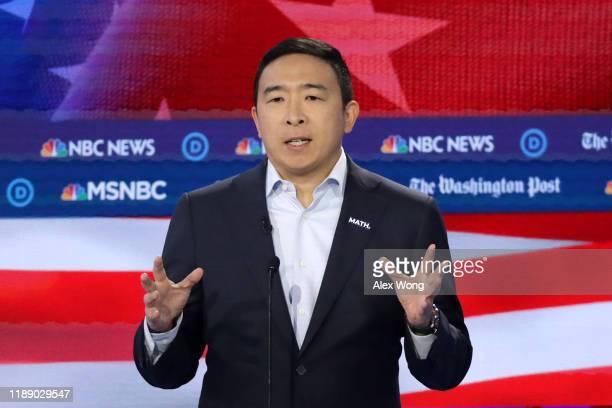 Democratic presidential candidate Andrew Yang speaks during the Democratic Presidential Debate at Tyler Perry Studios November 20, 2019 in Atlanta,...