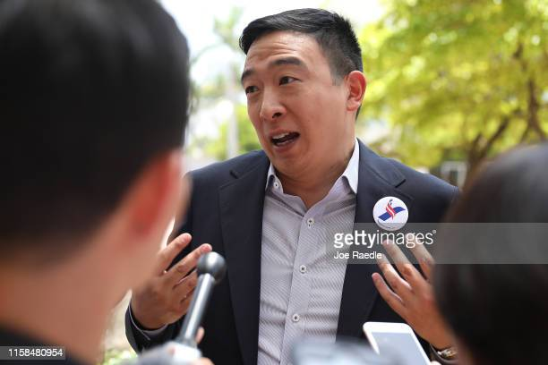 Democratic presidential candidate Andrew Yang speaks to media outside the Knight Concert Hall of the Adrienne Arsht Center for the Performing Arts of...