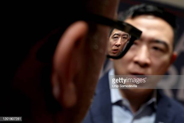 Democratic presidential candidate Andrew Yang talks to journalists following a town hall meeting at CoxSnow Recital Hall at Central College January...