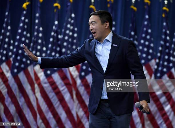 Democratic presidential candidate Andrew Yang waves as he arrives at the 2020 Gun Safety Forum hosted by gun control activist groups Giffords and...