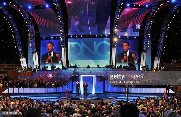 Democratic presidential candidate Barack Obama addresses the Democratic National Convention with running mate Joe Biden on August 27 2008 at the...