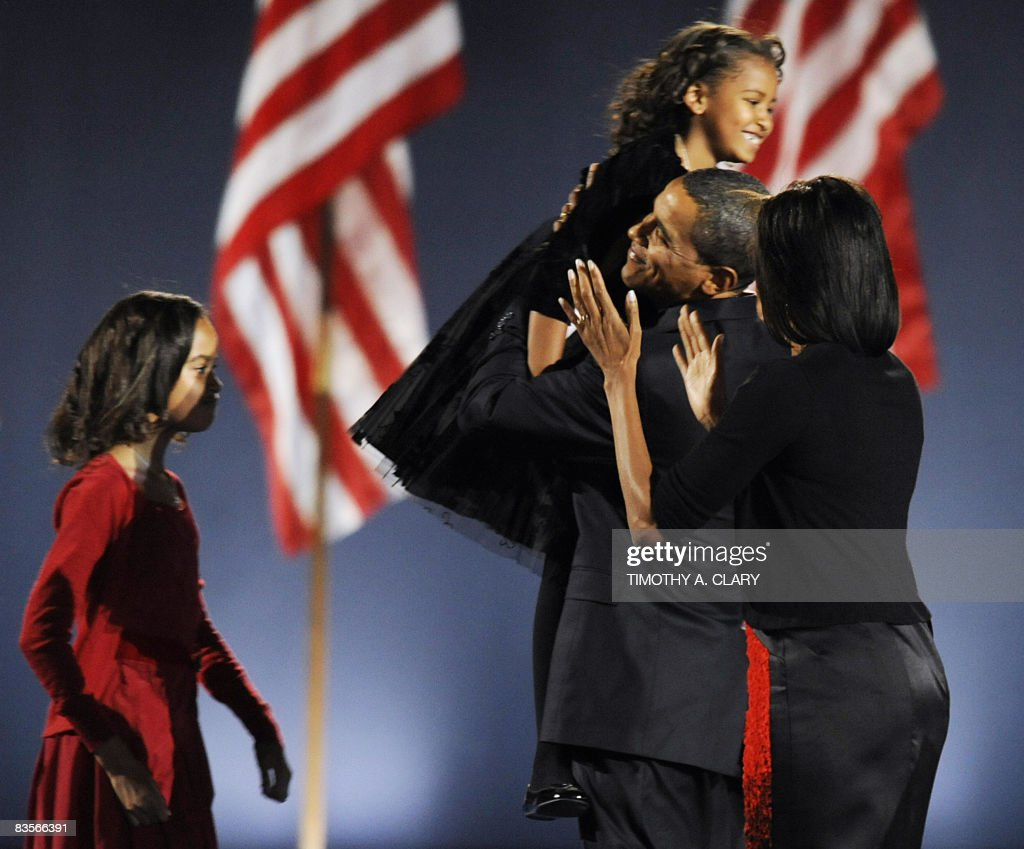 Democratic presidential candidate Barack Obama and family stand on stage during his election night victory rally at Grant Park on November 4, 2008 in Chicago, Illinois. Americans emphatically elected Obama as their first black president in a transformational election which will reshape US politics and the US role on the world stage.