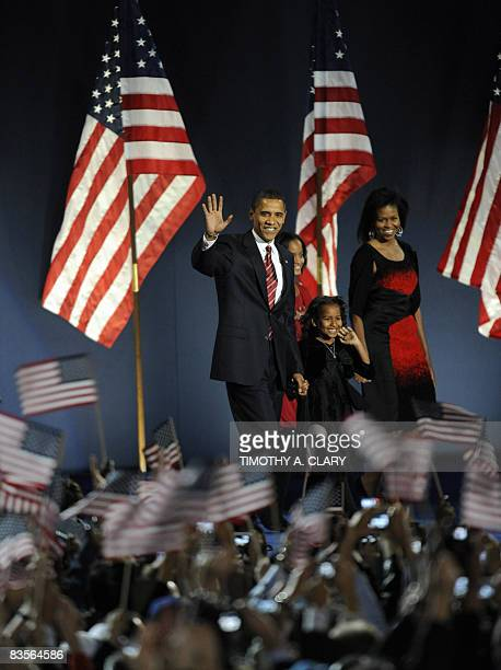 Democratic presidential candidate Barack Obama and his family arrive on stage for his election night victory rally at Grant Park on November 4 2008...