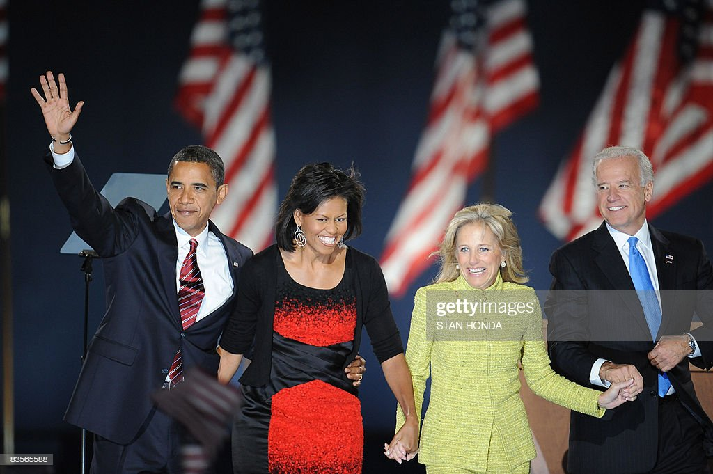 Democratic presidential candidate Barack Obama and his wife Michelle stand on stage with running mate Joe Biden and his wife Jill during their election night victory rally at Grant Park on November 4, 2008 in Chicago, Illinois. Americans emphatically elected Obama as their first black president in a transformational election which will reshape US politics and the US role on the world stage. AFP PHOTO / Stan HONDA