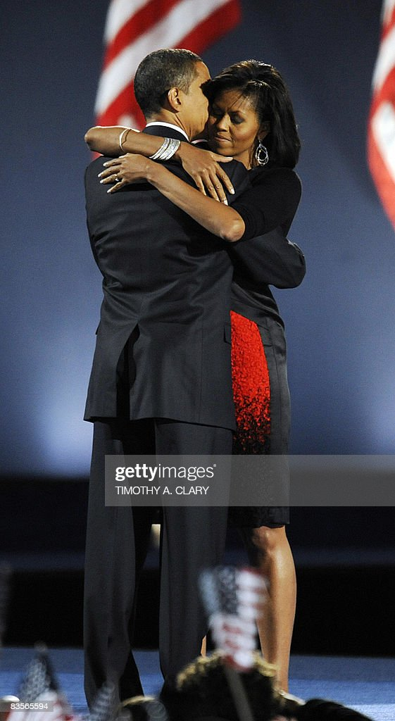 Democratic presidential candidate Barack Obama and his wife Michelle embrace on stage after Obama addressed his election night victory rally at Grant Park on November 4, 2008 in Chicago, Illinois. Americans emphatically elected Obama as their first black president in a transformational election which will reshape US politics and the US role on the world stage.